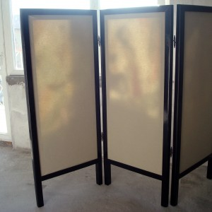 Three fold textile screen with wooden frame - back